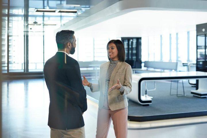 women-man-talking-corporate-office